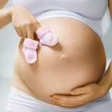 A pregnancy belly and cute boots. Mammary cyst when pregnant - expected mom should know.