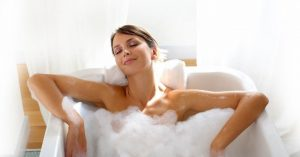 woman takes a warm bath to reduce pain in right groin